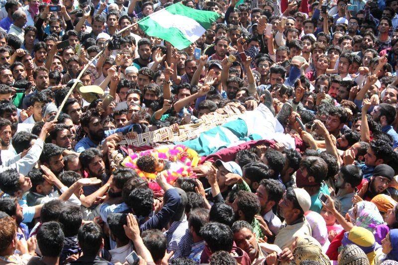 People in large numbers participate in the funeral of one of the two militants killed in an operation by the security forces in Sopore town of Jammu and Kashmir on June 1, 2017.