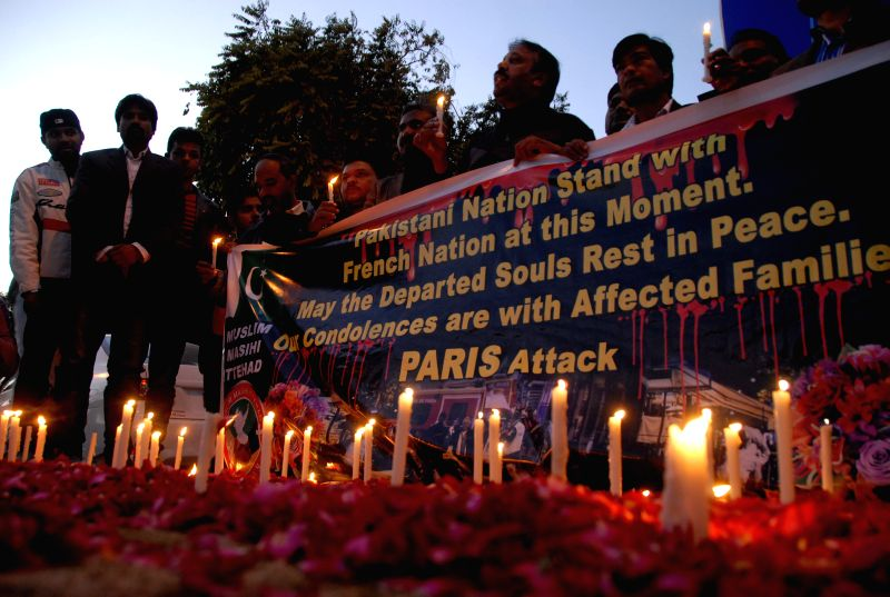 People light candles for the victims of the Paris terror attacks during a mourning ceremony in Islamabad, Pakistan, on Nov. 16, 2015.