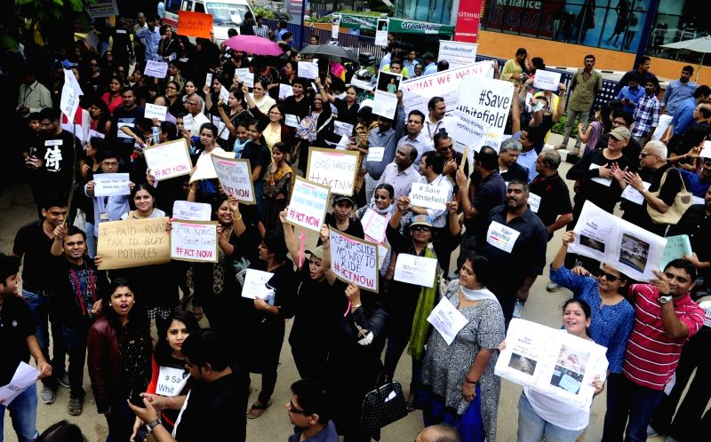 People living and working in and around the Whitefield area protest against the government during a `Save Whitefield` campaign at Whitefield in Bengaluru on Nov 30, 2015.