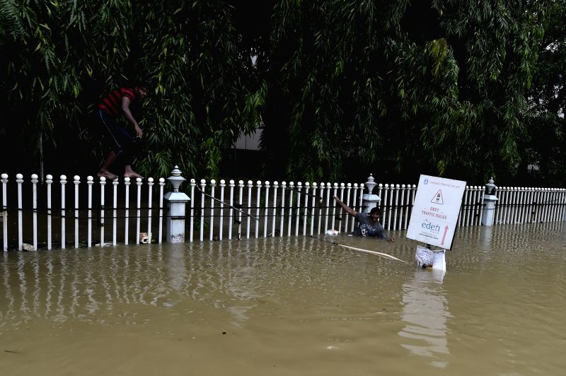 People move out from water logged areas after fresh rain lashes Chennai on Dec 2, 2015.