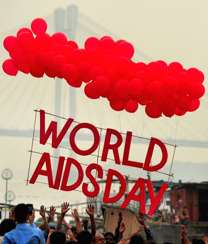 People observe World Aids Day in Kolkata, on Dec 1, 2015.