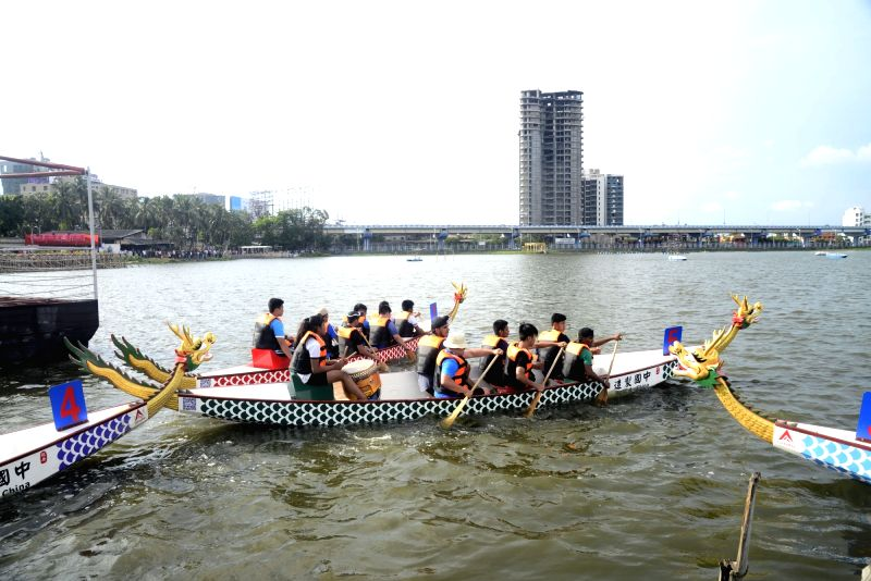 People of Chinese origin participate in a Dragon Boat Festival in Kolkata on June 11, 2017.