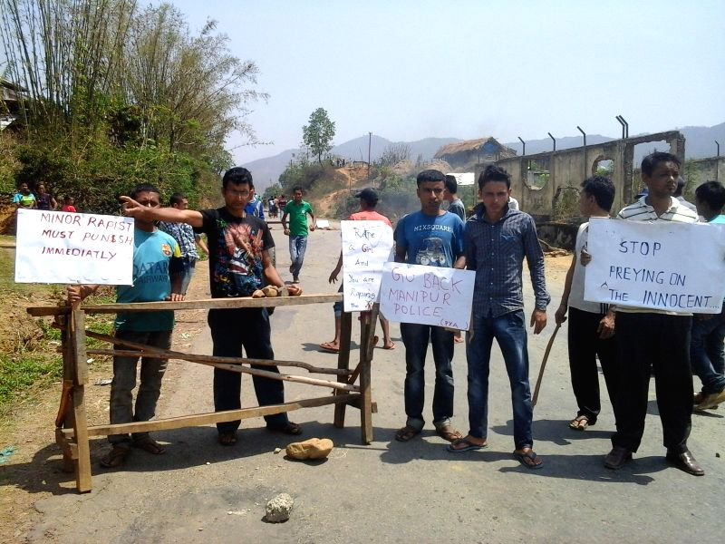 People of Sadar Hill district blocking NH102 between Imphal and Kohima by burning tyres and putting cut trees and heavy boulders while protesting against the alleged rape of a minor girl on 16th by a