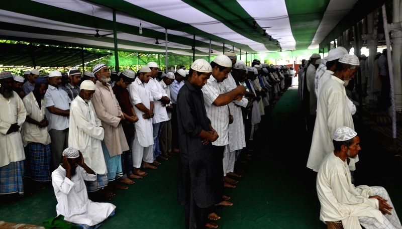 People offer Namaz at Burha Masjid during Ramadan in Guwahati on July 4, 2014.