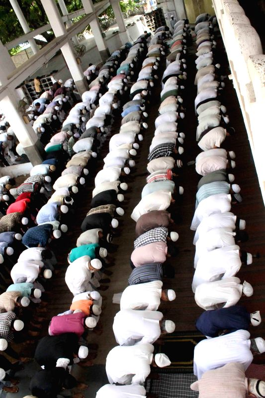 People offer Namaz at Mallepally Mosque during Ramadan in Hyderabad on July 4, 2014.