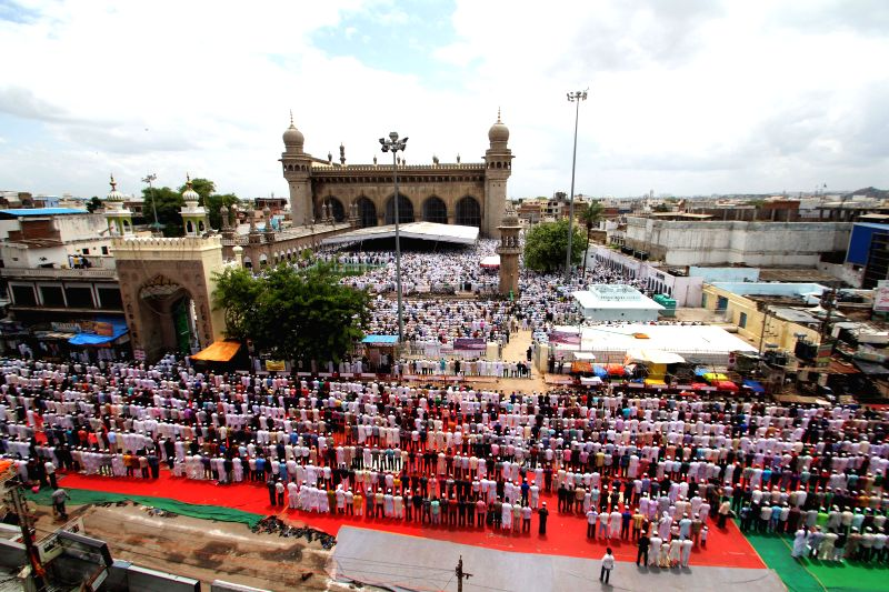 People offer Namaz on Juma-tul-Vida, the last Friday of the holy month of Ramadan at Mecca Masjid during Ramadan in Hyderabad on July 25, 2014.