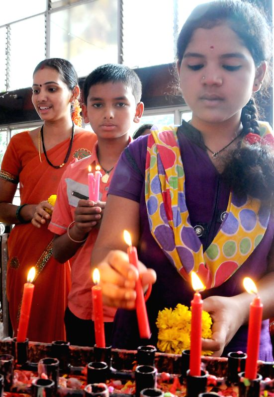 People offer prayers at a church on Good Friday in Bangalore on April 18, 2014.