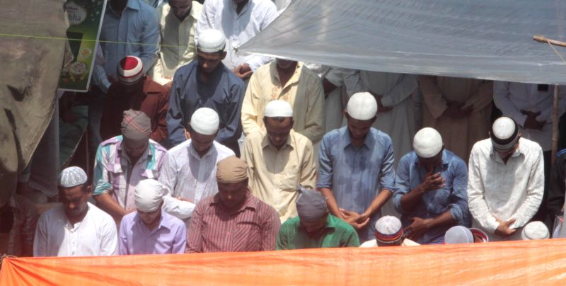 People offer prayers on Juma-tul-Wida, the last Friday of the holy month of Ramadan in at Nakhoda Masjid in Kolkata on July 25, 2014.