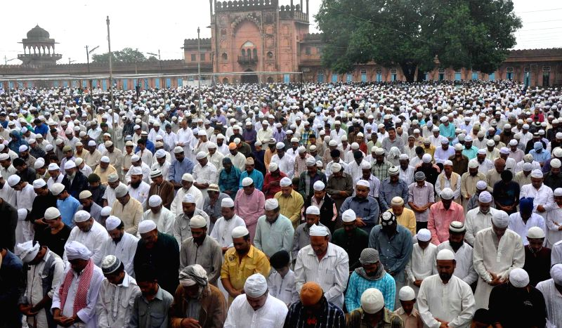 People offer prayers on Juma-tul-Wida, the last Friday of the holy month of Ramadan at a mosque in Bhopal on July 25, 2014.