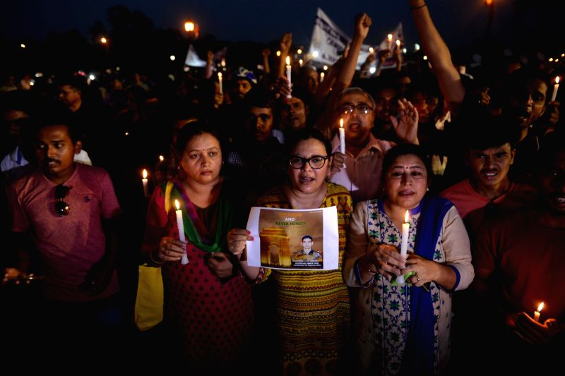 People participate during a candlelight vigil in honour of Lieutenant Ummer Fayaz, a young Kashmiri Army officer who was abducted and murdered by suspected Hizbul militants in Shopian ...