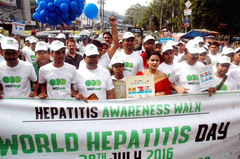 People participate during a Hepatitis Awareness Rally on the occassion of World Hepatitis Day in Patna on July 28, 2016.