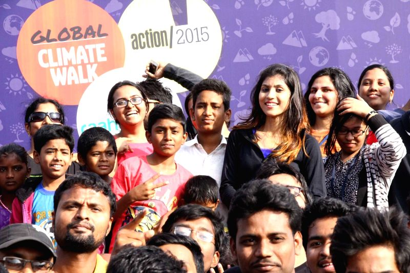 People participate during a programme organised to spread awareness on Global climate ahead of the Paris UN COP21 in Hyderabad on Nov 29, 2015.