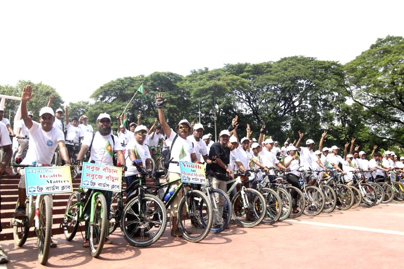 People participate in a bicycle rally organised on  International Youth Day 2014 in Dhaka, Bangladesh on Aug 12, 2014.