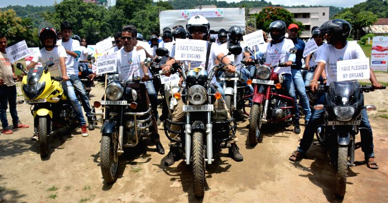 People participate in a bike rally organised on Organ Donation Day in Guwahati on Aug 6, 2014.
