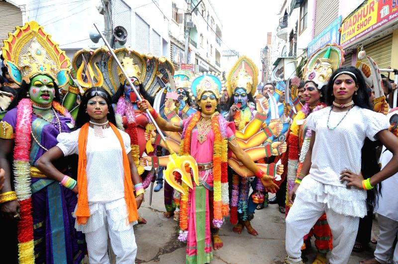 People participate in a Bonalu procession at Mahakali Temple in Secunderabad on July 14, 2014.