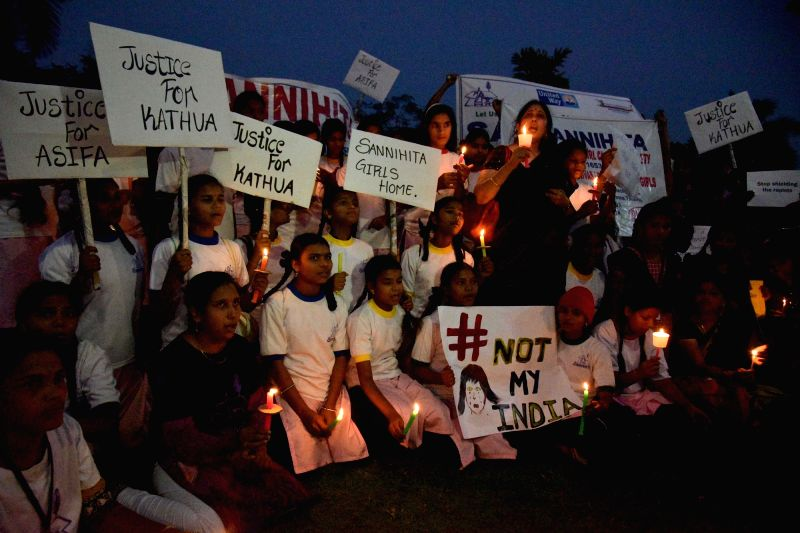 People participate in a candle light vigil organised to express solidarity with Kathua rape and murder victim, in Hyderabad on April 13, 2018.