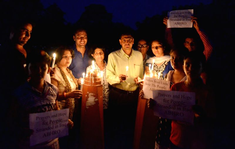 People participate in a candlelight vigil organised to pray for the safety of Indian nationals trapped in violence hit Iraq in Amritsar on June 19, 2014.