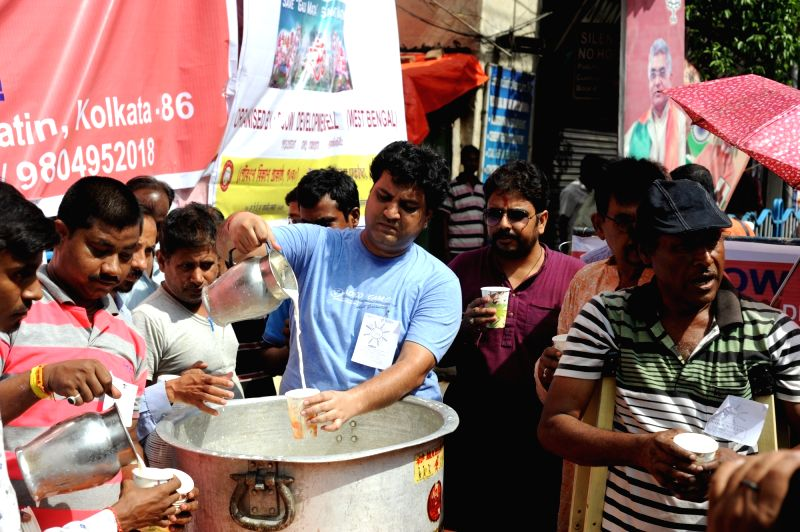 "People participate in a ""cow milk party"" organised by BJP in Kolkata, on June 10, 2017."