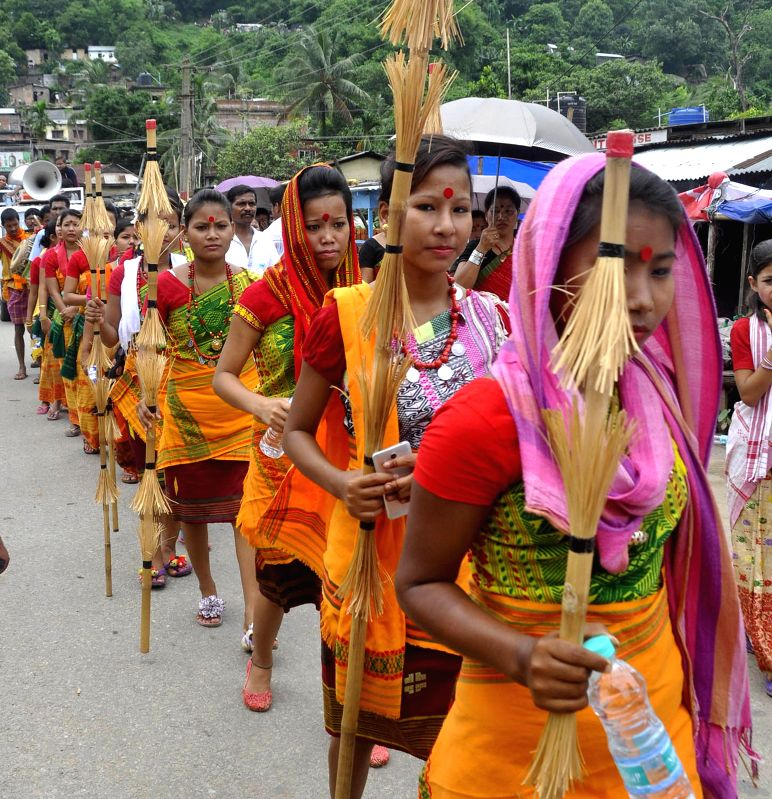 People participate in a cultural procession taken out to mark Bishnu Rabha Divas in Guwahati on June 20, 2014.