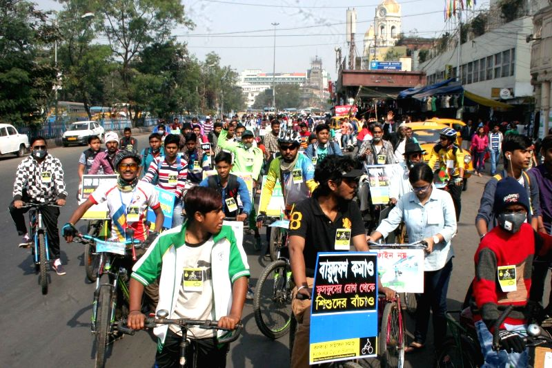 People participate in a cycle rally to spread awareness about Air Pollution, in Kolkata on Jan 28, 2018.
