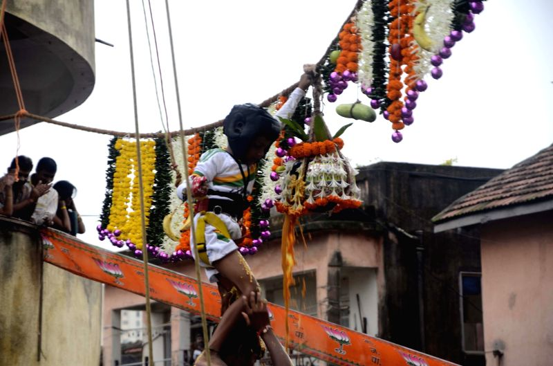 People participate in a `dahi-handi` competition organised on Janmashtami in Mumbai on Aug 18, 2014.