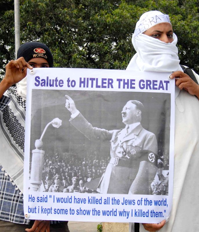 People participate in a demonstration in Bangalore to protest against Israeli attacks on Gaza on July 18, 2014.
