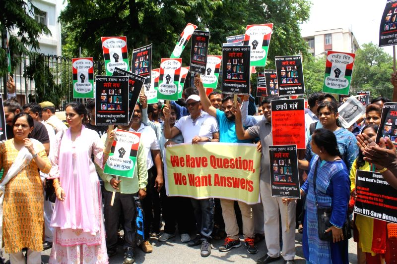 People participate in a demonstration organised to press for protection of whistle blowers,in New Delhi, on July 18, 2018.