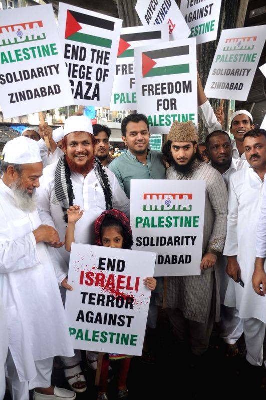 People participate in a demonstration to protest against Israeli attacks on Gaza in Mumbai on July 18, 2014.