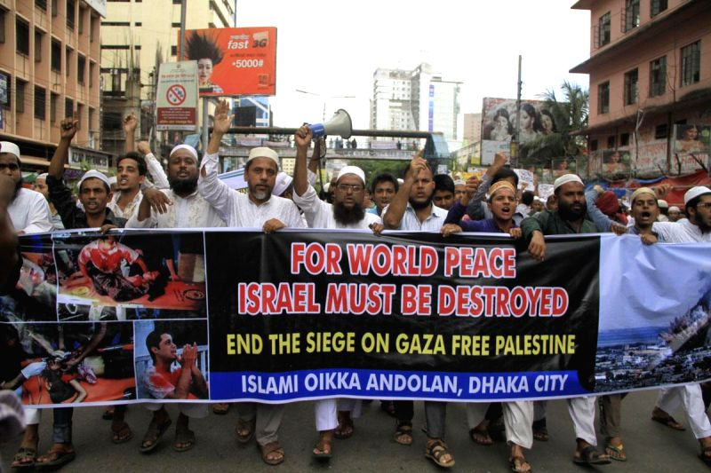 People participate in a demonstration to protest against Israeli attacks on Gaza in Dhaka, Bangladesh on July 18, 2014.