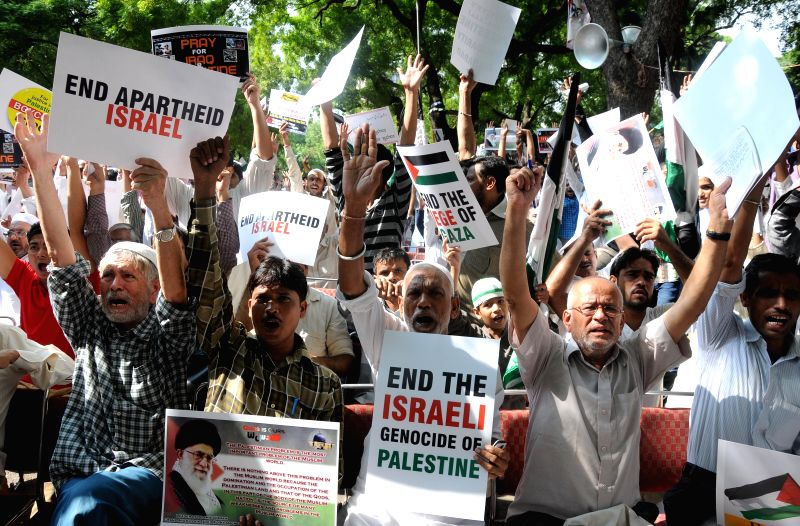 People participate in a demonstration to protest against Israeli attacks on Gaza in New Delhi on July 25, 2014.