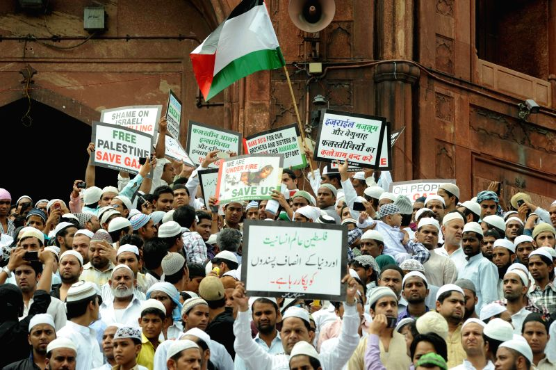 People participate in a demonstration to protest against Israeli attacks on Gaza at Jama Masjid in New Delhi on July 25, 2014.