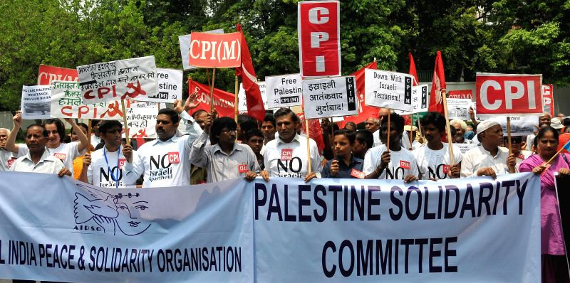 People participate in a left rally organised to protest against Israeli attacks on Gaza in New Delhi on July 17, 2014.