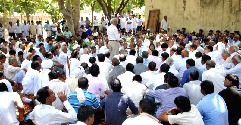 People participate in a mahapanchayat held to discuss removal of Kherki Daula toll plaza on Nation Highway 8, at Narsing village in Gurgaon district of Haryana on Aug 24, 2014.