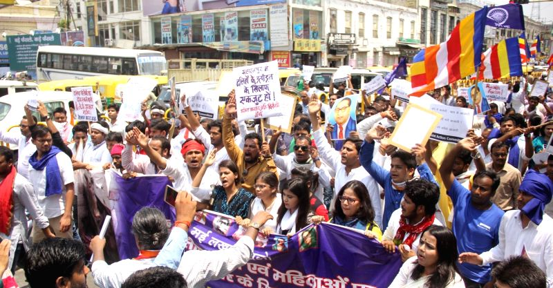 People participate in a march against Saharanpur violence in Lucknow on May 31, 2017.