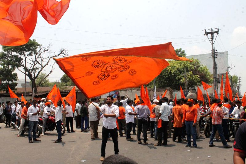 People participate in a procession organised on Hanuman Jayanti in Secunderabad on April 15, 2014.