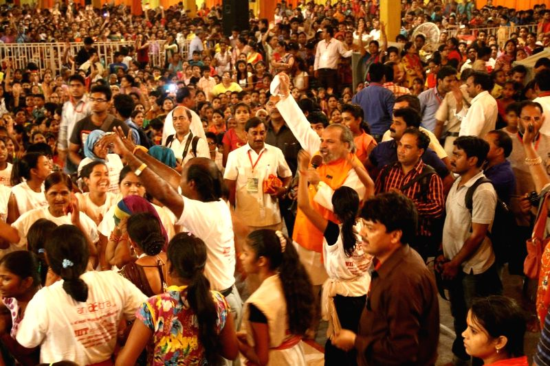 People participate in a programme organised on Janmashtami in Delhi on Aug 17, 2014.