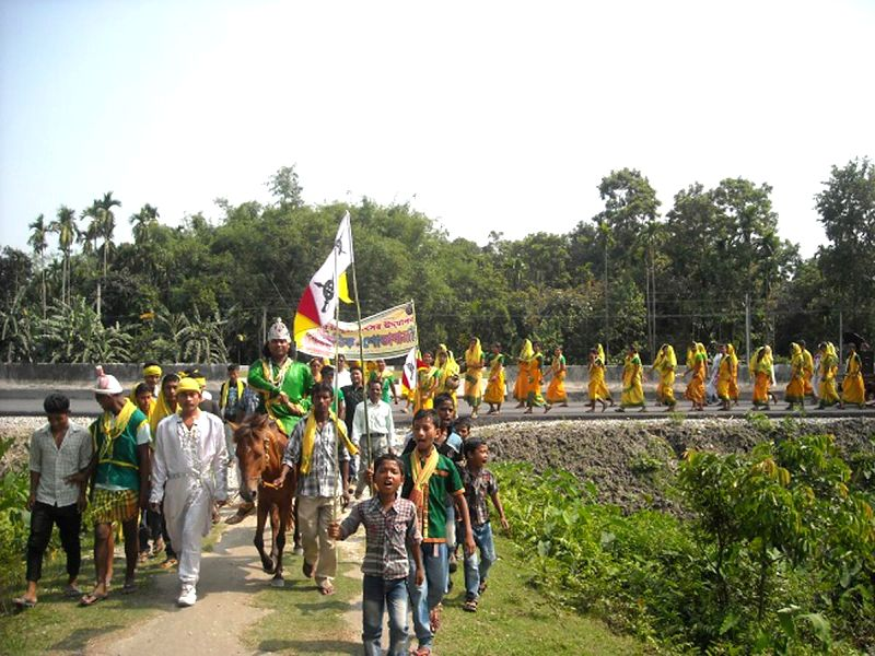 People participate in a rally during  'BISHUA' organised by AKRSU in Noapara of Assam on May 12, 2014.