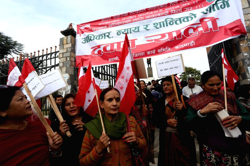 People participate in a rally of opposition party to pressure the government for solutions to the Madhes crisis and the Indian blockade, in Kathmandu, Dec. 2, ...