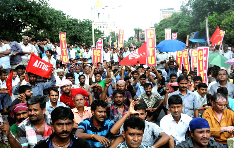 People participate in a rally organised by Left Trade Union against atrocities of Bengal Police in Kolkata on Aug 11, 2014.
