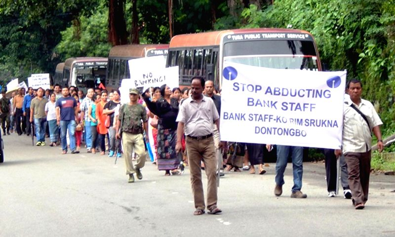 People participate in a rally organised by SBI employees to demand release of Subodh Kumar Mishra, a bank official who was abducted at gunpoint from Gasuapara in South Garo Hills on 5th August 2014, . - Subodh Kumar Mishra