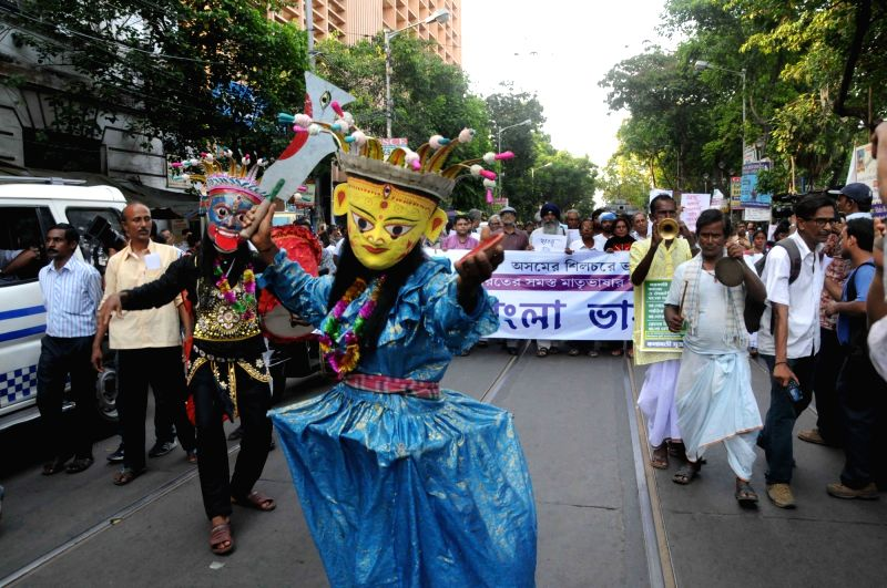 People participate in a rally organised in the memory of language martyrs of Silchar (Assam) in Kolkata, on May 19, 2017.