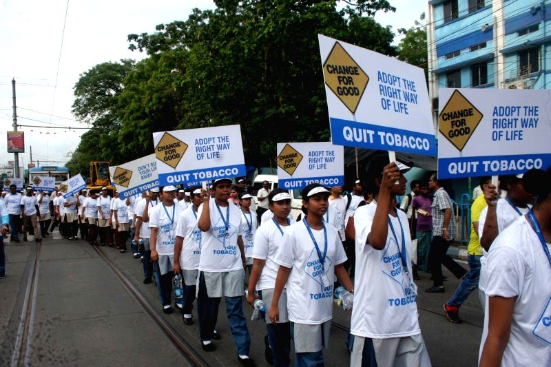 People participate in a rally organised on the eve of World No Tobacco Day in Kolkata on May 30, 2017.
