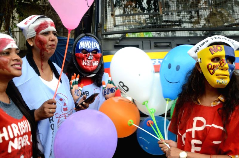 People participate in a rally organised on the 73rd anniversary of the bombing of Japanese city of Hiroshima; in Mumbai on Aug 6, 2018.