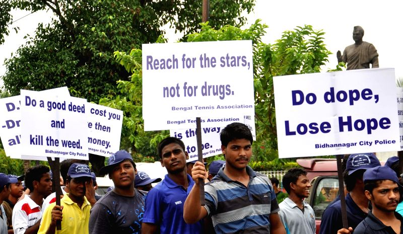 People participate in a rally organised on United Nations' International Day Against Drug Abuse and Illicit Trafficking in Kolkata on June 26, 2014.
