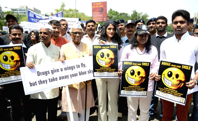 People participate in a rally organised on United Nations' International Day Against Drug Abuse and Illicit Trafficking organised by Rehabilitation from Alcohol Substance Abuse and Prevention and ...