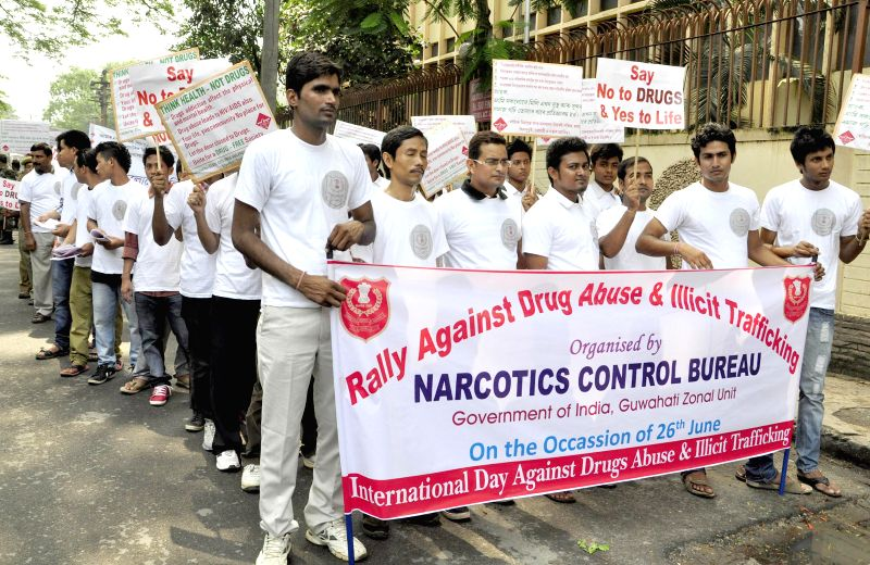 People participate in a rally organised on United Nations' International Day Against Drug Abuse and Illicit Trafficking in Guwahati on June 26, 2014.