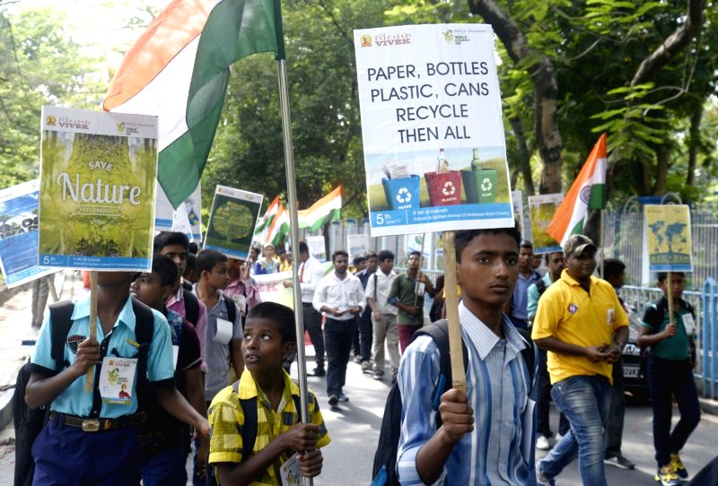 People participate in a rally organised on World Environment Day in Kolkata, on June 5, 2017.