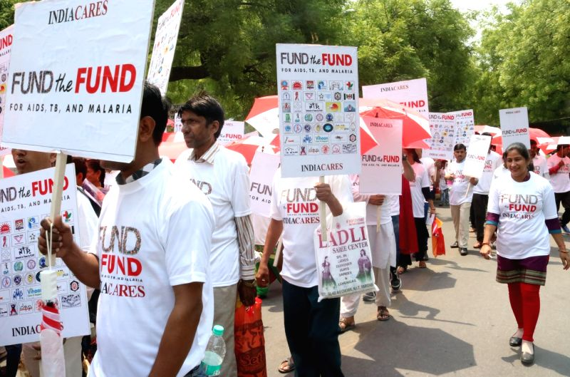 People participate in a rally organised to demand funds for victims of AIDS, TB and Malaria in New Delhi, on May 10, 2016.