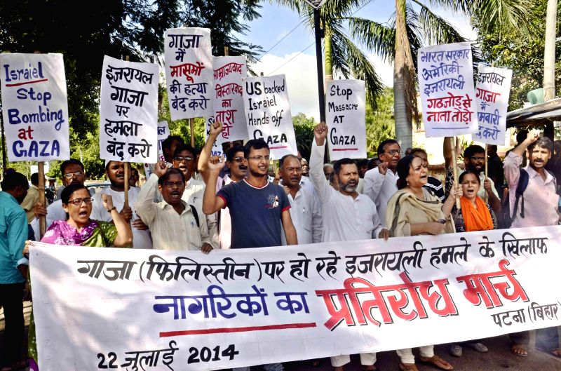People participate in a rally to protest against Israeli attack on Gaza in Patna on July 22, 2014.