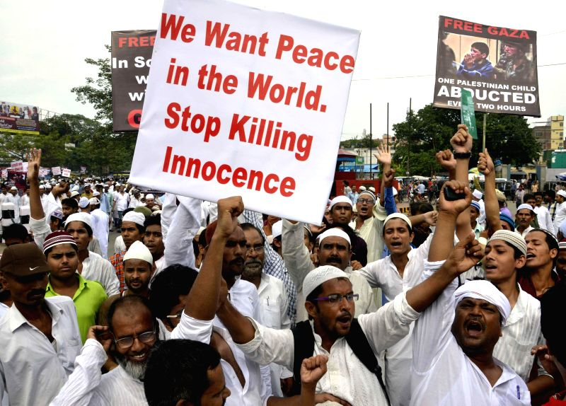People participate in a rally to protest against Israeli attack on Gaza in Patna on July 25, 2014.
